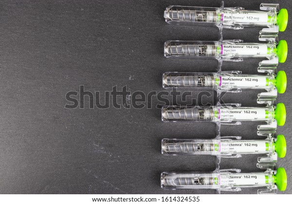 LEEDS, UNITED KINGDOM - Jan 27, 2019: Array of Tocilizumab injection right side of the frame on a slate background.