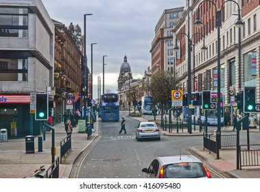 Leeds, The United Kingdom. Traffic and people at Leeds city center. Taken on 2016/04/17