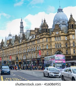 Leeds, The United Kingdom. Transport at Leeds city center and Leeds City Market building. Taken on 2016/04/16
