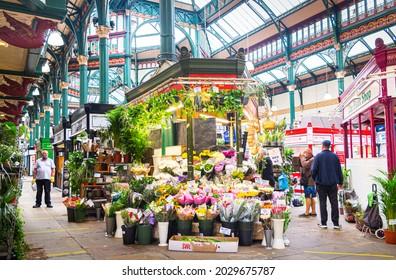 Leeds, West Yorkshire, England - August 20 2021: A florist stall in Leeds Kirkgate market