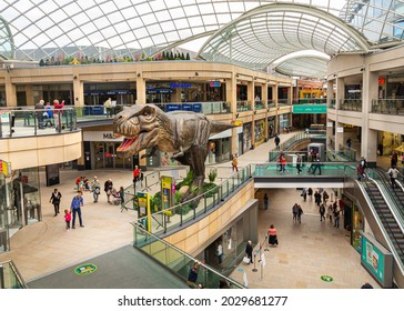 Leeds, West Yorkshire, England - August 20 2021: Trinity shopping mall in Leeds City Center with a life size tyrannosaurus rex trex