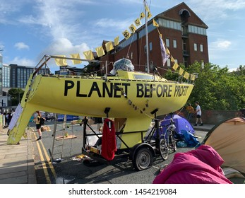 LEEDS, WEST YORKSHIRE, UK - JULY 18, 2019: EXTINCTION REBELLION PROTESTERS GATHERING OUTSIDE BRIDGEWATER PLACE ON THE OUTSKIRTS ON THE CITY CENTRE
