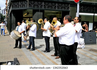 Leeds, Yorkshire, UK. July 12, 2015, A group of musicians busking on Briggate on a sunny Sunday at Leeds in Yorkshire, UK.