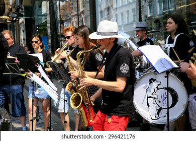 LEEDS, YORKSHIRE, UK. JULY 12, 2015.   The bare brass band busking on Briggate the main shopping street on a Sunday at  Leeds in Yorkshire, UK.