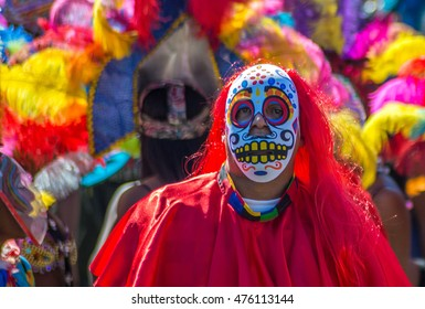 LEEDS, YORKSHIRE, UK:  Male participant dressed in red costume wearing skull mask parades at Potternewton Park during the Leeds West Indian Carnival on August 29, 2016 in Leeds, UK.