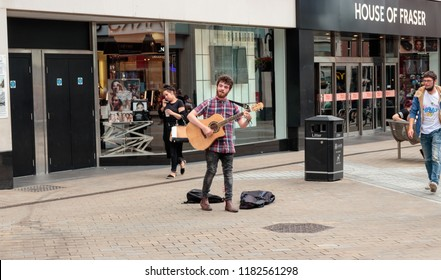 LEEDS, YORKSHIRE, UNITED KINGDOM - AUGUST 15, 2018: Unidentified male busking on Briggate