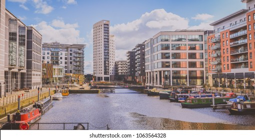 Leeds, Yorkshire/The United Kingdom - 16 April 2016: A view at modern houses by the river of Aire in Leeds