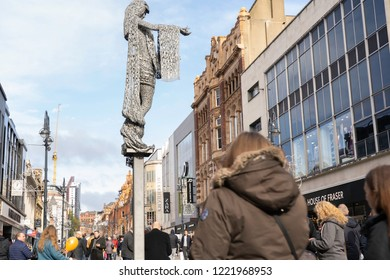 Leeds,West Yorkshire,United Kingdom. 10.27.2018.The Briggate Minerva towering over shoppers at a shopping centre.
