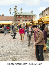 Leek, Staffordshire, England,U.K- April,19th 2014 : People shopping at Leek open air market, Leek  is an ancient borough and was granted its royal charter in 1214.