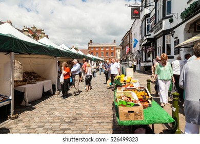 Leek, Staffordshire Moorlands, England, U.K - June 21 2014 : Shoppers at Leek open air market Leek  is an ancient borough and was granted its royal charter in 1214.