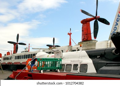"""Lee-on-the-Solent, Hampshire, UK - June 10 2017: Young boy standing in front of obsolete hovercraft """"The Princess Anne"""" at the Hovercraft Museum in England"""