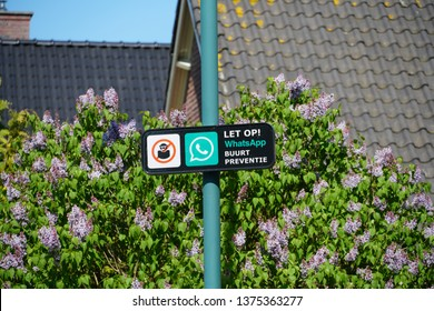 Leersum, the Netherlands. April 2019. A sign indicating a neighborhood watch is active in the area, using Whatsapp for communication.