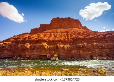 Lee's Ferry is a historic boat ferry across the Colorado River. Stormy wide river with rapids and steep banks of red sandstone and cold water. USA. The concept of active and photo tourism