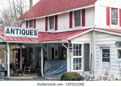 Leesburg, USA - April 6, 2018: Rural Virginia countryside mountain in spring with house building store and sign for My Wits End Antiques