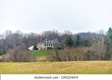 Leesburg, USA - April 6, 2018: Rural Virginia farm countryside mountain scenery in spring with house building and green grass lawn