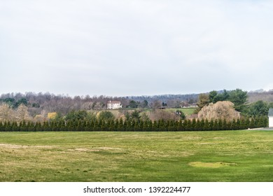 Leesburg, USA - April 6, 2018: Rural Virginia farm countryside mountain scenery in spring with house or farmhouse building and green grass lawn