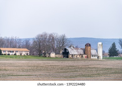 Leesburg, USA - April 6, 2018: Rural Virginia farm countryside mountain scenery in spring with house and silo farmhouse building