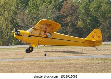 Leesburg, VA / USA - September 28, 2019: A Piper Cub flies at the Leesburg Air Show in Leesburg, VA.