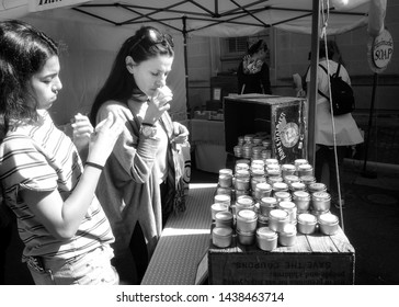 Leesburg, Virginia April 28, 2019: People shopping a soap venodr's wares at the Leesburg Flower and Garden Festival
