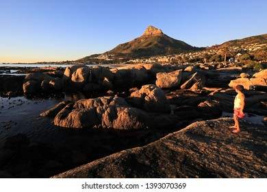 Leeukop in Cape Town as seen from the tidal pool at Camp's Bay on a beautiful sunny afternoon. The wall of the tidal pool in on the right hand side.