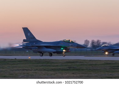 Leeuwarden Feb 6 2018: Night flight Exercise. F-16 Fighting Falcon taking off in the evening sun.