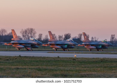 Leeuwarden Feb 6 2018: Night flight Exercise. F-16's preparing for take off off in the evening sun.