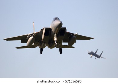 LEEUWARDEN, NETHERLANDS - APR 11, 2016: Two US Air Force F-15 Eagle fighter jets landing.