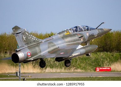 LEEUWARDEN, THE NETHERLANDS - APR 21, 2016: French Air Force Dassault Mirage 2000D fighter jet plane from Escadron de Chasse 2/3 landing on Leeuwarden airbase during military exercise Frisian Flag