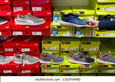 LEEUWARDEN, THE NETHERLANDS - APRIL 27, 2018: Puma and Adidas brand sneakers in a sportswear shop.