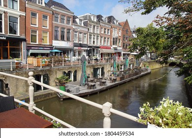 Leeuwarden, Netherlands, August 26, 2020. Canal, bridge, terraces, street, shops, houses in Leeuwarden, Friesland, Netherlands. Quiet because of the corona.