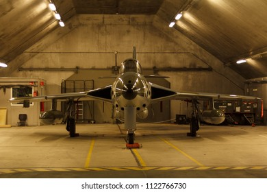 Leeuwarden, Netherlands - Feb 6 2018: Hawker Hunter in the dim light of a shelter