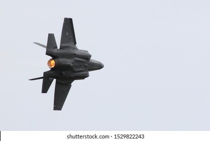 Leeuwarden, The Netherlands - JUN 10, 2016: The first Dutch F-35 is flying through the sky with the afterburner on during an airshow by the Dutch Air Force.