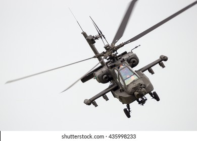 LEEUWARDEN, THE NETHERLANDS - JUN 10, 2016: Boeing AH-64 Apache attack helicopter flying a demo during the Royal Netherlands Air Force Days