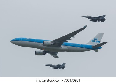 LEEUWARDEN NETHERLANDS June 11 2016: Airbus A330 of the KLM escorted by two F-16 of the Royal Dutch Airforce