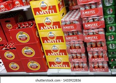 LEEUWARDEN, THE NETHERLANDS - MARCH 11, 2015: Stack of Amstel beer crates and cans in a wholesale. Amstel Brewery is a Dutch brewery owned by Heineken International.