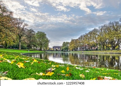 Leeuwarden, The Netherlands, November 3, 2018: fallen leaves in the grass of the bank of Noorderstadsgracht canal