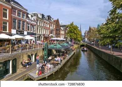 Leeuwarden, Netherlands, September 2016. People enjoying the sun on the terraces near a canal in the center of Leeuwarden