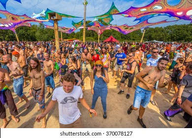 LEEUWARDEN, NETHERLANDS-AUGUST 30, 2015: Laughing happy party people having fun on the dance floor at Psy-Fi open air psychedelic trance music Festival
