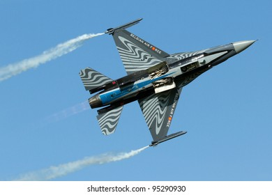 "LEEUWARDEN,FRIESLAND,HOLLAND-SEPTEMBER 17: Belgian F-16 Solo Display team at the ""Luchtmachtdagen"" Airshow on September 17, 2011 at Leeuwarden Airfield,Friesland,Holland"