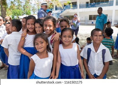 Lefaga, Upolu, Samoa - August 2, 2018: Primary school children posing for tourists photographs in the playground