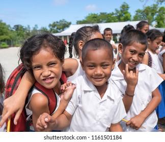 Lefaga, Upolu, Samoa - August 2, 2018: Primary school children with attitude