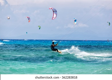 Lefkada, Greece, August 12 2015: Kitesurfers on the Milos beach in Lefkada. Milos beach is most popular places in Greece for kitesurfing.