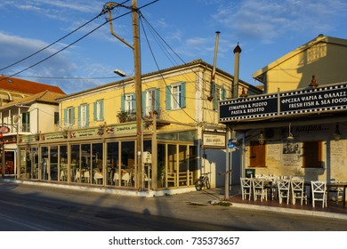 Lefkada, Greece - October 2, 2017: Coffee shops and restaurants at the seafront of Lefkada harbour in Greece.