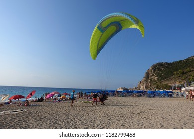 Lefkada, Ionian / Greece - August 21 2018: Photo of paragliders landing in famous beach of Kathisma