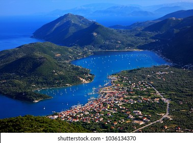 LEFKADA ISLAND, IONIAN SEA, GREECE. Panoramic view of Vlychos bay and Nydri town from Skaroi mountain.