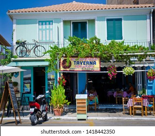LEFKADA TOWN, GREECE - AUGUST 29, 2016: Typical Greek tavern.  Most restaurants are located at the port promenades of tourists places, like Lefkada Town.