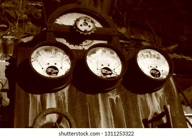 Left abandoned in an old industrial park, a ancient set of unknown gauges makes for a compelling, retro, steampunk display of vintage machinery