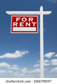 Left Facing For Rent Real Estate Sign on a Blue Sky with Clouds.