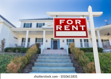 Left Facing For Rent Real Estate Sign In Front of House.