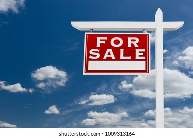 Left Facing For Sale Real Estate Sign Over Blue Sky and Clouds With Room For Your Text.